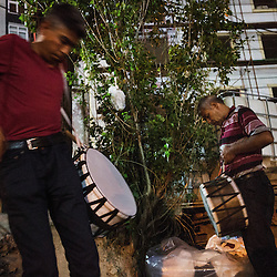 Yağup Kapcak and his nephew Aşır Kapcak, 25,  prepare their drums before heading to work as Ramadan drummers in Istanbul.  Yağup comes from a family of drummers. His father and brothers are drummers as well. For him drumming is as much of a job as it is a family tradition.