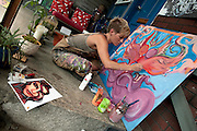 Rachel Brooks works on a painting during the Brattleboro, Vermont Gallery Walk.