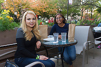 """The Hyde Park Chamber of Commerce held its 2015 Dinner Trek Tuesday evening. Participants were invited to try samples of food from restaurants along 55th and 57th Street between Cottage Grove and the lakefront.<br /> <br /> 0845 – Blanca Campos and Auryana Jarvis enjoy food from Noodles Etcetera located at 1333 E. 57th Street.<br /> <br /> Please 'Like' """"Spencer Bibbs Photography"""" on Facebook.<br /> <br /> All rights to this photo are owned by Spencer Bibbs of Spencer Bibbs Photography and may only be used in any way shape or form, whole or in part with written permission by the owner of the photo, Spencer Bibbs.<br /> <br /> For all of your photography needs, please contact Spencer Bibbs at 773-895-4744. I can also be reached in the following ways:<br /> <br /> Website – www.spbdigitalconcepts.photoshelter.com<br /> <br /> Text - Text """"Spencer Bibbs"""" to 72727<br /> <br /> Email – spencerbibbsphotography@yahoo.com"""