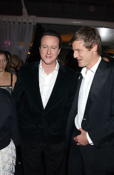 Left to right, leader of The Conservatives DAVID CAMERON MP and ZAC GOLDSMITH at the Conservative Party's Black & White Ball held at Old Billingsgate, 16 Lower Thames Street, London EC3 on 8th February 2006.<br />