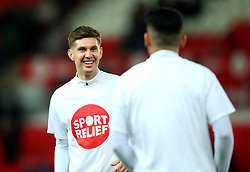 John Stones of Manchester City wears a Sport Relief top during the warm up at Stoke City - Mandatory by-line: Robbie Stephenson/JMP - 12/03/2018 - FOOTBALL - Bet365 Stadium - Stoke-on-Trent, England - Stoke City v Manchester City - Premier League