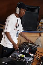 DJ mixing on decks at the St Anns; Nottingham Holding Hands festival,