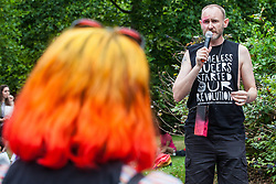 London, UK. 6 July, 2019. David Tovey of the Museum of Homelessness addresses activists from Lesbians and Gays Support The Migrants, African Rainbow Family, the Outside Project, Micro Rainbow and other LGBT+ groups preparing to take part in a London Pride Solidarity March in solidarity with those for whom Pride in London is inaccessible and in protest against the corporatisation of Pride in London.
