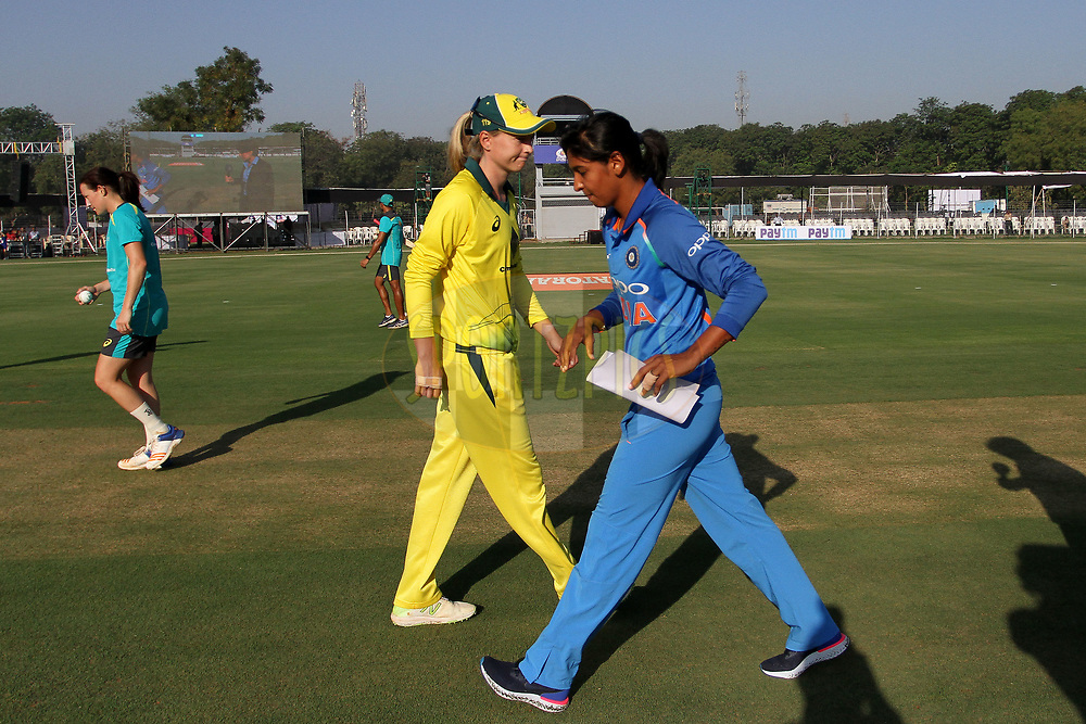 Harmanpreet Kaur of India and Meg Lanning captain of Australia during the toss of the first women's one day International ( ODI ) match between India and Australia held at the Reliance Cricket Stadium in Vadodara, India on the 12th March 2018<br /> <br /> Photo by Vipin Pawar / BCCI / SPORTZPICS
