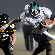 West Brunswick's Dylan Darguzas rushes past Topsail's Chris Byrd. (Jason A. Frizzelle)