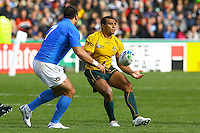 AUCKLAND, NEW ZEALAND - SEPTEMBER 11:  Will Genia of Australia passes during the IRB 2011 Rugby World Cup Pool C match between Australia and Italy at North Harbour Stadium on September 11, 2011 in Auckland, New Zealand.  (Photo by Teaukura Moetaua/Getty Images) *** Local Caption *** Will Genia