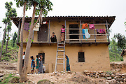 Nisha Darlami (top left), 19, stays for a month after the birth of her baby girl, Bushpa, at her mother's (top right) house in Kalyan Village, Surkhet district, Western Nepal, on 30th June 2012. Nisha eloped with her step nephew when she was 13 but the couple used contraceptives for the next 6 years to delay pregnancy until she turned 18. In Surkhet, StC partners with Safer Society, a local NGO which advocates for child rights and against child marriage. Photo by Suzanne Lee for Save The Children UK