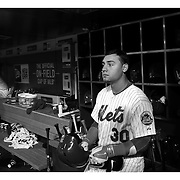 Michael Conforto, New York Mets, preparing to bat in the dugout during the New York Mets Vs Atlanta Braves MLB regular season baseball game at Citi Field, Queens, New York. USA. 22nd September 2015. Photo Tim Clayton