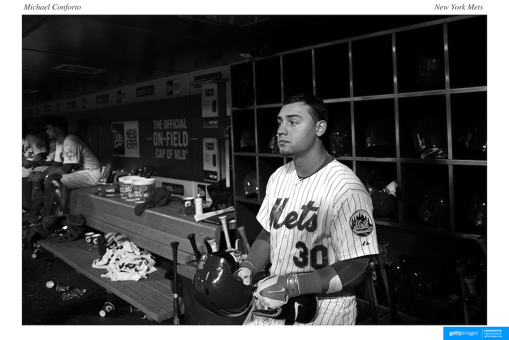 Michael Conforto, New York Mets, preparing to bat in the dugout during the New York Mets Vs Atlanta Braves MLB regular season baseball game at Citi Field, Queens, New York. USA. 22nd September 2015. Photo Tim Clayton