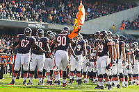25 November 2012: Defensive end (90) Julius Peppers of the Chicago Bears enters the field during player introductions before playing against the Minnesota Vikings before the Bears 28-10 victory over the Vikings in an NFL football game at Soldier Field in Chicago, IL.