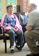 Chaplain Blaik Westhoff (cq) converses with patient Carmen Reyes 79, (left) during Spirit Alive, a religious service for people with dementia that incorporates Montessori principles Wednesday, June 28, 2017 at Meadow Glen Personal Care in Richlandtown, Pennsylvania. (WILLIAM THOMAS CAIN / For The Philadelphia Inquirer)