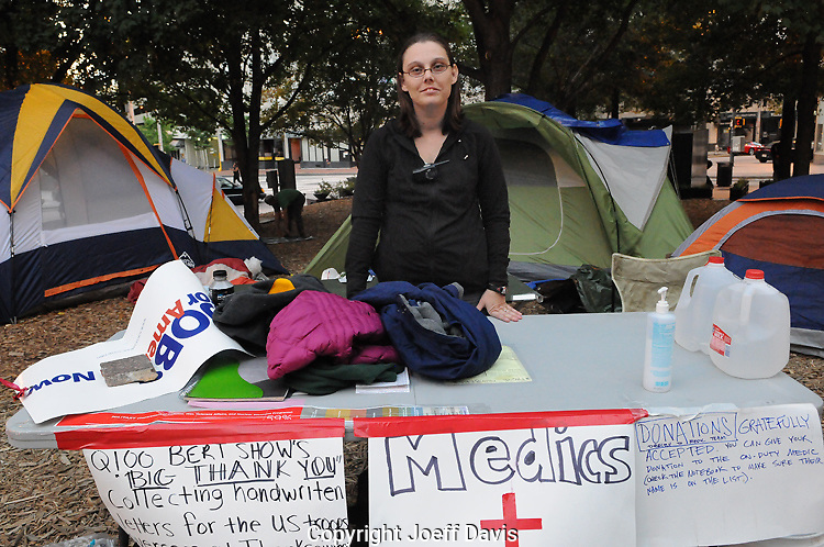 "October 15, 2011 - Lisa Mestas, a registered nurse, has been working the medic tent at Occupy Atlanta for a week. ""I have 4 kids so I bring them to school and then I come here."" She says she has treated mostly bumps and bruises at the Occupy site. ""I will be here as long as it takes for the government and corporations to pay attention to what we are saying. We want the best lives for our kids."""