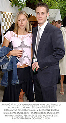 Actor GARY LUCY from footballers wives and friend, at a party in London on 8th June 2002.	PAS 71