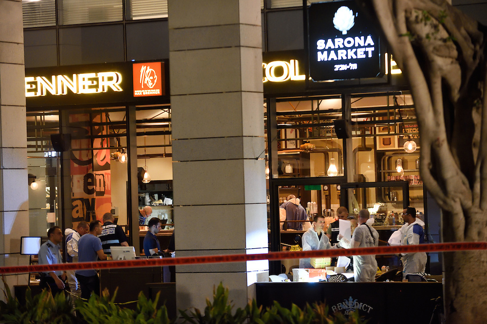 Policemen are investigating the scene of a shooting attack in Sarona Market, Tel-Aviv on June 08'th, 2016. Four Israelis were killed and and 16 wounded in a shooting attack in Sarona Market at Tel-Aviv, performed by two Palestinian attackers. Photo by Gili Yaari.