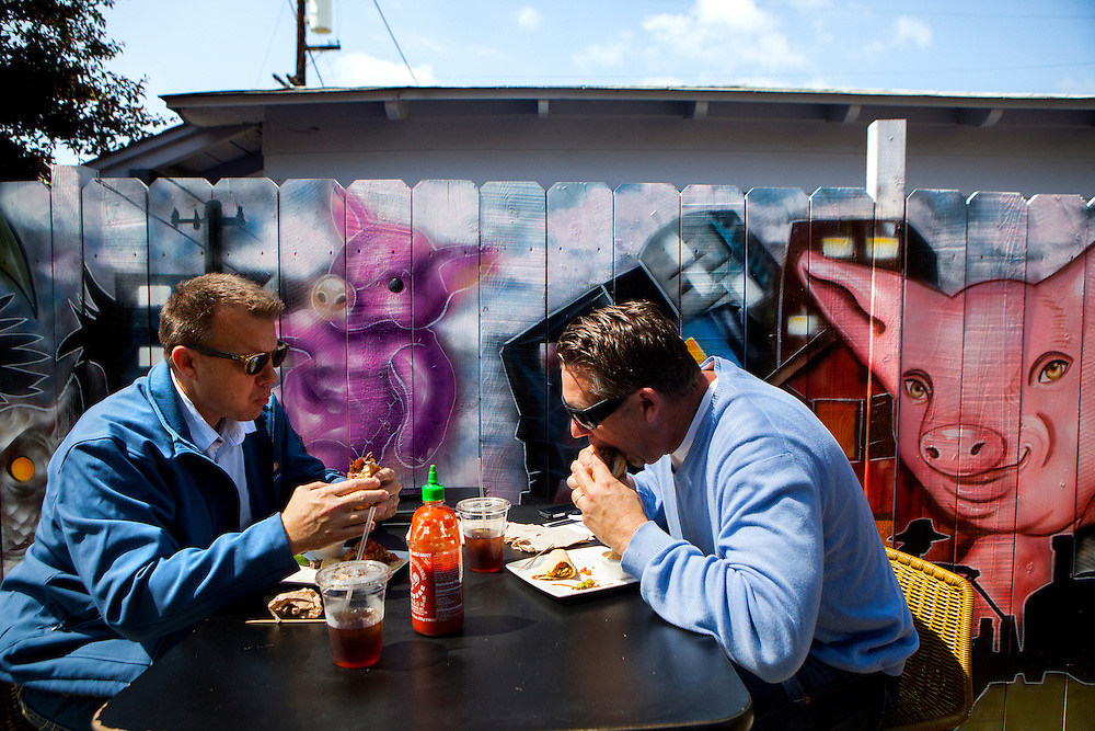 Craig Duhs and Scott Duhs enjoy lunch at Carnitas' Snack Shack on Friday, March 22, 2013 in San Diego, California, U.S.