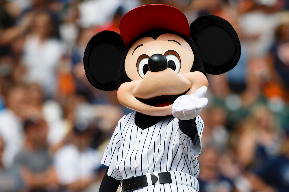 Aug 9, 2015; Detroit, MI, USA; Mickey Mouse performs during the seventh inning stretch of the game between the Detroit Tigers and the Boston Red Sox at Comerica Park. Mandatory Credit: Rick Osentoski-USA TODAY Sports