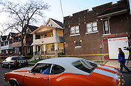 Cleveland police are parked in front of the home of Anthony Sowell at 12205 Imperial Avenue in Cleveland on Wednesday November 4, 2009. Police have discovered as many as 11 bodies in the home as of November 5, 2009...