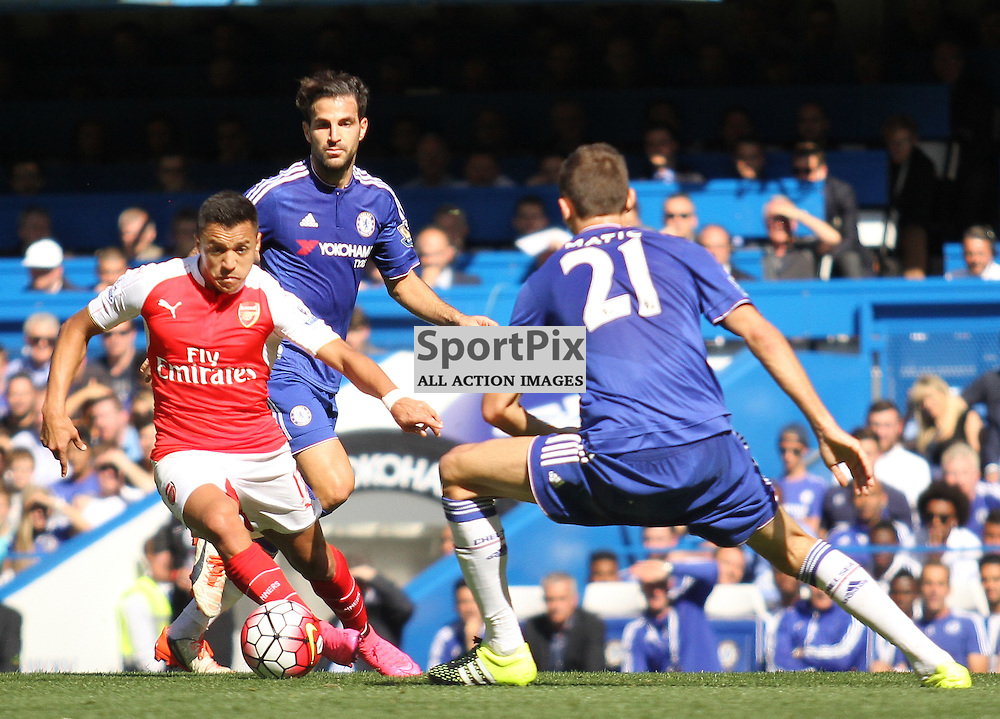 Arsenals Alexis Sanchez takes on Chelsea Nemanja Matic