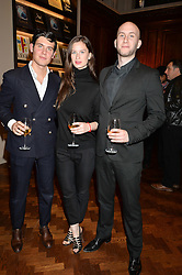 Left to right, ALEX ASSOULINE, ALEXANDRA KOLASINSKI and WLADIMIR KOLASINSKI at a party to celebrate the launch of the Maison Assouline Flagship Store at 196a Piccadilly, London on 28th October 2014.  During the evening Valentino signed copies of his new book - At The Emperor's Table.