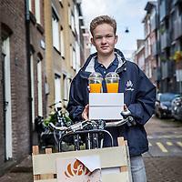 Nederland, Amsterdam, 3 juli 2016.<br /> De Croissant Boys, een familiebedrijf bestaande uit 3 broers die zondagochtend tussen 9-12 uur verse croissants met roomboter en/of jam en verse jus d'orange bij u thuis bezorgt.<br /> Op de foto: Bezorger Willem Rosier.<br /> <br /> The Croissant Boys, a family business consisting of three brothers who deliver fresh croissants with butter and / or jam and fresh orange juice to your home on sunday mornings between 9-12 am.  <br /> <br /> Foto: Jean-Pierre Jans