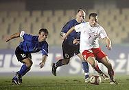 JEREZ 03/02/2007..MECZ TOWARZYSKI POLSKA _ ESTONIA ...NA ZDJ. RAFAL MURAWSKI /POLSKA/ , Z TYLU MARTIN REIM /16/ I LIIVO LEETMA /10/ - OBAJ ESTONIA..FOT. PIOTR HAWALEJ / WROFOTO
