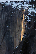 For only a few days a year, the setting sun lights up the seasonal horsetail falls, cascading down the sheer face of El Capitan in Yosemite National Park.