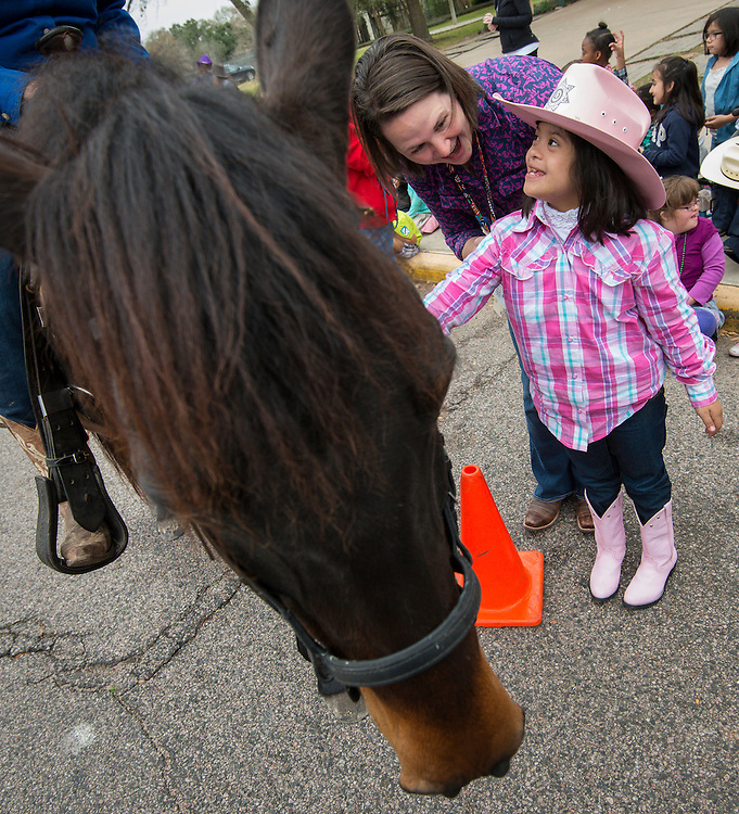 Students and staff from Kolter Elementary School meet the Vaqueros Trail Riders as part of Go Texan Day, February 28, 2014.