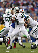 New York Jets quarterback Geno Smith (7) drops back to pass as Buffalo Bills defensive tackle Kyle Williams (95) smacks at the ball and causes a strip fumble that gives the Bills a first down with goal to go inside the Jets 5 yard line during the NFL week 11 football game against the Buffalo Bills on Sunday, Nov. 17, 2013 in Orchard Park, N.Y. The Bills won the game 37-14. ©Paul Anthony Spinelli