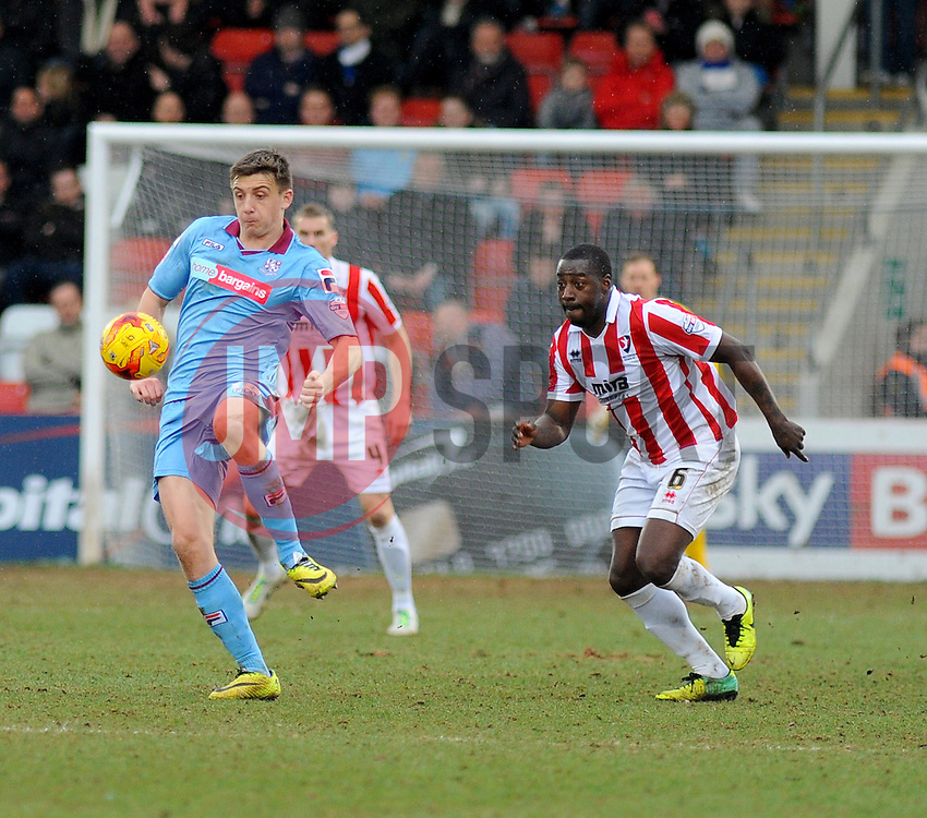 Cheltenham Town's Pablo Mills challenges for the ball against Tranmere Rovers's Adam Dugdale - Photo mandatory by-line: Nizaam Jones - Mobile: 07966 386802 - 28/02/2015 - SPORT - Football - Cheltenham- Whaddon Road - Cheltenham Town v Tranmere Rovers - Sky Bet League Two