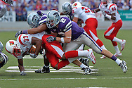Kansas State safety Marcus Watts (2) brings down Louisville running back Kolby Smith (33) for no gain in the second half at Bill Snyder Family Stadium in Manhattan, Kansas, September 23, 2006.  The 8th ranked Louisville Cardinals beat K-State 24-6.