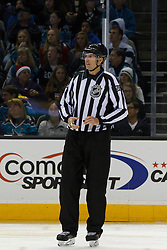 Dec 23, 2011; San Jose, CA, USA; NHL linesman Shane Heyer (55) before a face off between the San Jose Sharks and the Los Angeles Kings during the second period at HP Pavilion. San Jose defeated Los Angeles 2-1 in shootouts. Mandatory Credit: Jason O. Watson-US PRESSWIRE