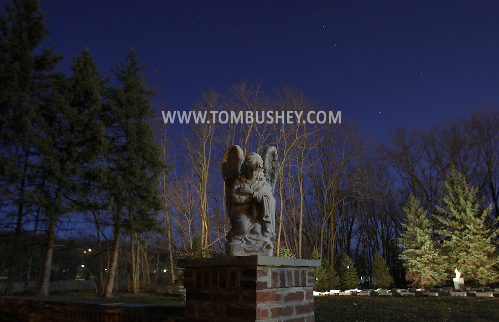Middletown, New York - An angel in the moonlight outside the cemetery at the National Shrine of Our Lady of Mount Carmel on March 19, 2011.
