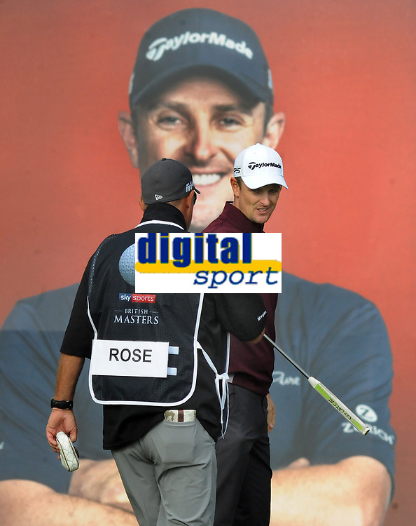 Golf - 2018 Sky Sports British Masters - Thursday, First Round<br /> <br /> Justin Rose of Great Britain, on the 18th with the backdrop of himself on the poster at Walton Heath Golf Club.<br /> <br /> COLORSPORT/ANDREW COWIE