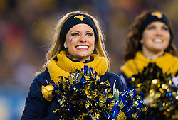 Dec 3, 2016; Morgantown, WV, USA; A West Virginia Mountaineers dance team member performs during the second quarter against the Baylor Bears at Milan Puskar Stadium. Mandatory Credit: Ben Queen-USA TODAY Sports