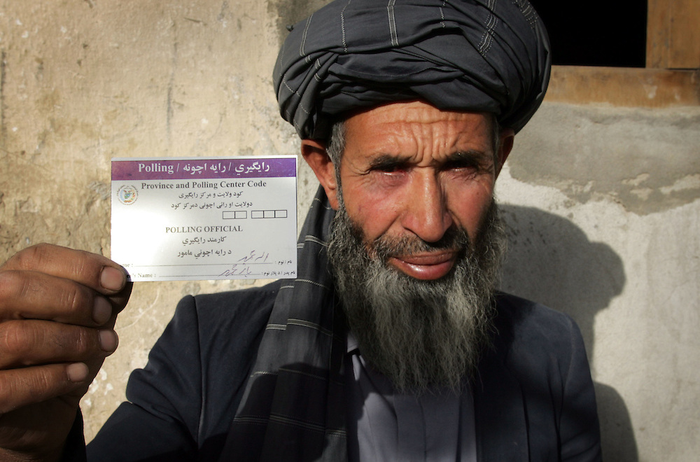 07 October 2004&amp;#xD;&amp;#xA;Kabul, Afghanistan.&amp;#xD;&amp;#xA;Election preparations in Afghanistan.&amp;#xD;&amp;#xA;&amp;#xD;&amp;#xA;&amp;#xD;&amp;#xA;&amp;#xD;&amp;#xA;With only days to go before voting in the Presidential elections begins throughout Afghanistan staff of polling centers are being issued with identification cards.<br />