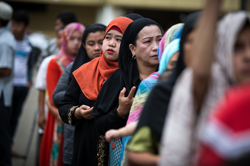 MARAWI, PHILIPPINES - JUNE 12: Muslim residents are seen praying during a symbolic flag raising ceremony in celebration of the Independence Day in Marawi City, Philippines on June 12, 2017. As fighting rages on for the third week, police hung Philippine flags  around war torn Marawi to boost troop morale. (Photo: Richard Atrero de Guzman/NUR Photo)<br />  <br /> <br /> <br /> Residents in tears during Lanao Del Sur Vice Governor Mamintal Adiong's emotional address to the displaced families of Marawi. Local executives and citizens gathered for a symbolic flag raising ceremony to assert civilian authority and unity in celebration of Independence Day in Marawi City, Philippines on June 12, 2017. (Photo: Richard Atrero de Guzman/NUR Photo)