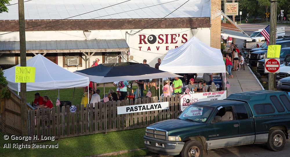 People gather at Rosie's Tavern near Abita Springs Park before fireworks on July 2, 2017