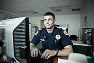 December 26th 2011,23 year old police officer, David DeSalvo, with the 5th District Power Squad, a specialized unit that patrols the city's toughest neighborhoods types up a  report after arresting a man who tossed a gun and ran from him.New Orleans crime rate is among the highest in America and is considered to be one of the most dangerous cities in the world.