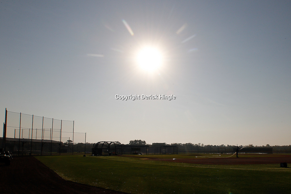 February 20, 2011; Port Charlotte, FL, USA; A grounds keeper prepares the field prior to the start of a spring training practice at Charlotte Sports Park.  Mandatory Credit: Derick E. Hingle