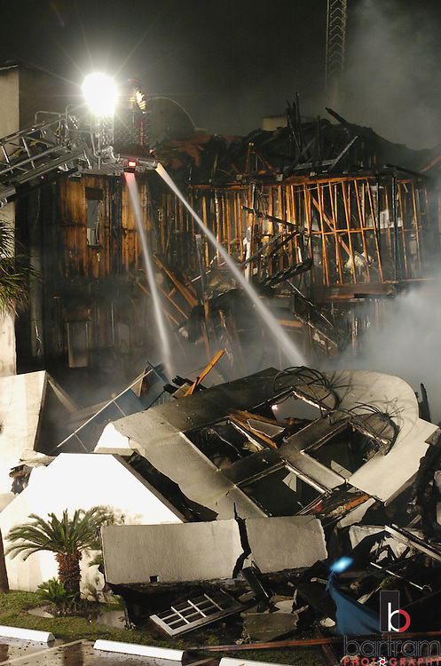 KEVIN BARTRAM/The Daily News.Galveston firefighters spray water onto a fire at the Seaside Village Apartments in the 4900 block of Fort Crockett Boulevard on Friday, April 23, 2004.
