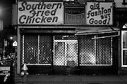 The shuttered store front of M & G Dinner in Harlem World New York City, NY