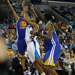 January 5, 2011; New Orleans, LA, USA; Golden State Warriors shooting guard Monta Ellis (8) and New Orleans Hornets guard Marcus Thornton (5) battle for a loose ball during the first half at the New Orleans Arena.   Mandatory Credit: Derick E. Hingle