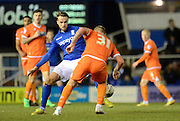 Andrew Shinnie attempts to tackle Jamie O'Hara during the Sky Bet Championship match between Birmingham City and Blackpool at St Andrews, Birmingham, England on 4 March 2015. Photo by Alan Franklin.