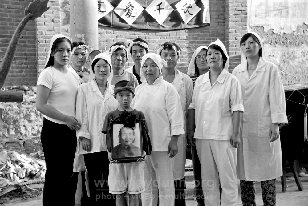 China, Shaanxi, 2007. Immediate relatives gather together for two days of mourning for their beloved grandmother. .