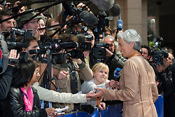 Christine Lagarde, France's finance minister, makes a statement to the media as she arrives for the emergency meeting of European Union finance ministers in Brussels, Belgium, on Sunday, May 9, 2010.  European Union finance ministers meet today to hammer out the details of an emergency fund to prevent a sovereign debt crisis from shattering confidence in the 11-year-old euro. (Photo © Jock Fistick)