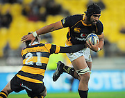 Taranaki's Beauden Barrett tries to stop Victor Vito. ITM Cup rugby union - Wellington Lions v Taranaki at Westpac Stadium, Wellington, New Zealand on Saturday, 16 October 2010. Photo: Dave Lintott / photosport.co.nz