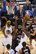 Golden State Warriors forward Draymond Green (23) takes the ball to the basket against the Houston Rockets at Oracle Arena in Oakland, Calif., on March 31, 2017. (Stan Olszewski/Special to S.F. Examiner)