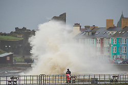 © London News Pictures. 15/11/2015. The tail end of Hurricane  Kate sweeps over the west of Wales bringing huge waves to crash against the harbour walls and promenade at Aberystwyth. Photo credit: Keith Morris/LNP