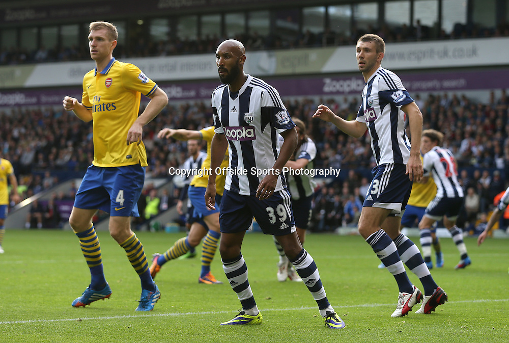 6th October 2013 - Barclays Premier League - West Bromwich Albion v Arsenal - Nicolas Anelka of West Brom (C) defends with teammate Gareth McAuley of West Brom (R) against Per Mertesacker of Arsenal (L) - Photo: Simon Stacpoole / Offside.