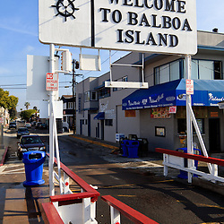 Photo of the Welcome to Balboa Island sign for the Balboa Island Ferry in Newport Beach California. The Balboa Island Ferry has been operating since 1919 and transports people and cars from Balboa Island to Balboa Peninsula across Newport Harbor (Newport Bay). Newport Beach is located along the Pacific Ocean in Orange County California in the United States.